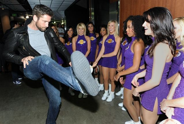 Gerard Butler tries to impress th LA Lakers cheerleaders with a high kick.